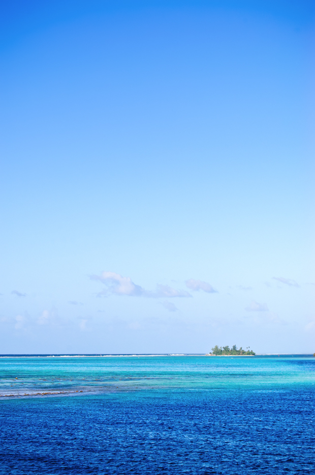 travel image of island and blue seas in the south pacific
