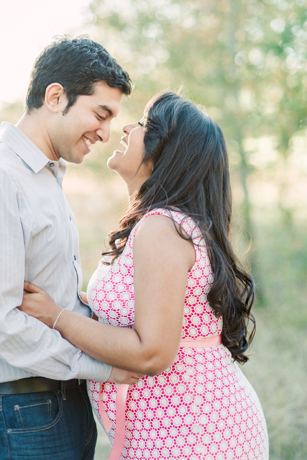 houston maternity portrait of couple laughing